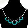 Coiled Rubber Scallop, KIT - Coiled Rubber Scallop Aluminum w/ Custom Rubber, simple chainmail necklace with small turquoise silicone rings on large jump rings on a black jewelry display bust